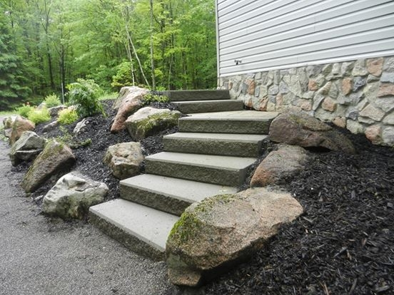 Curving stairway with garden bordered by natural granite stones