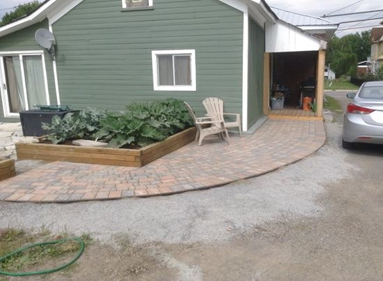 Curved interlock walkway with wood planter boxes