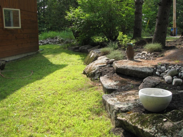 Natural stone stairs in a natural stone retaining wall