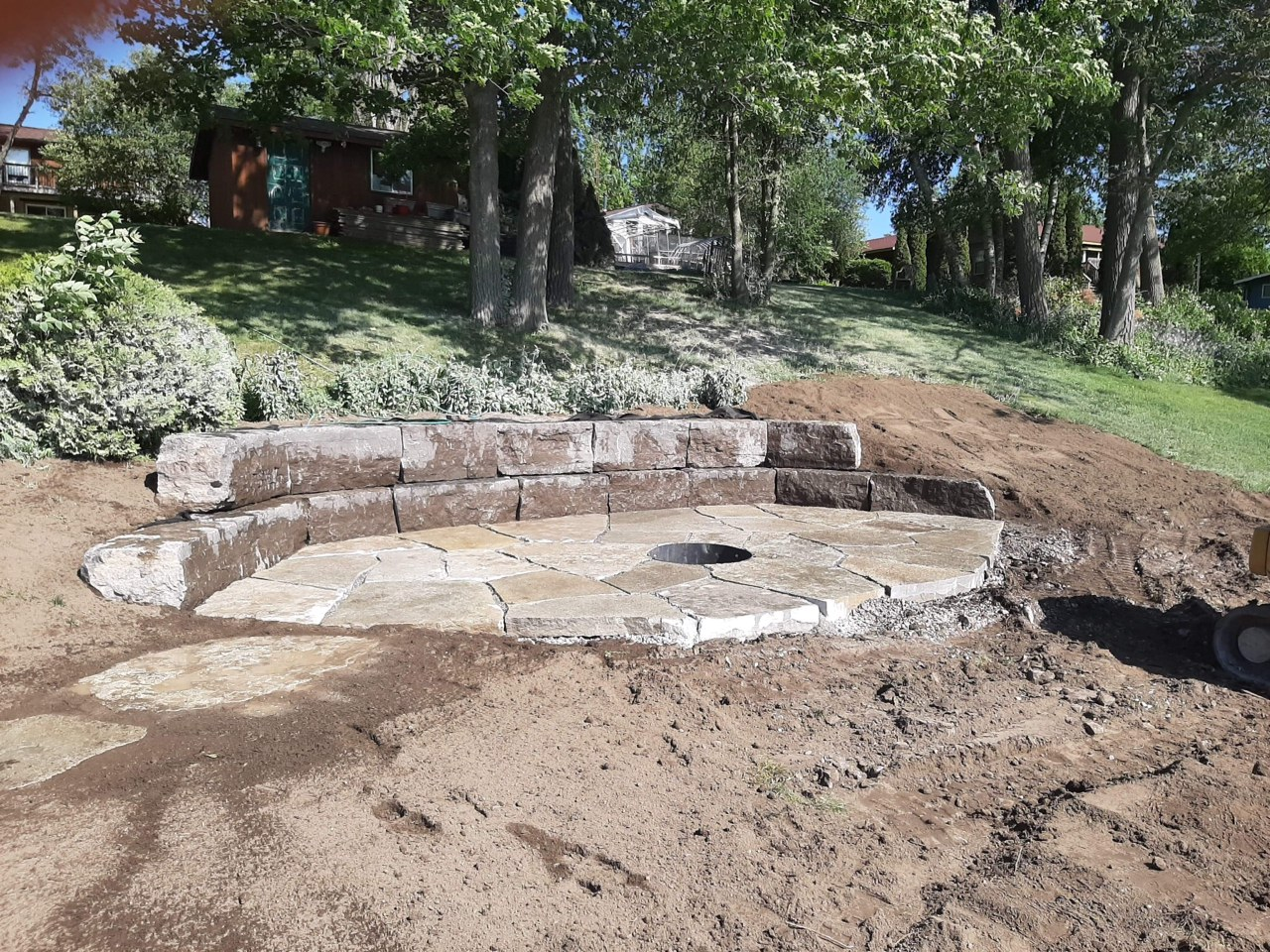 Retaining wall and large flagstone patio with fire pit